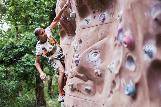 May 30, 2013 - Nainital, Uttarakhand, India: Man free climbing on rock wall