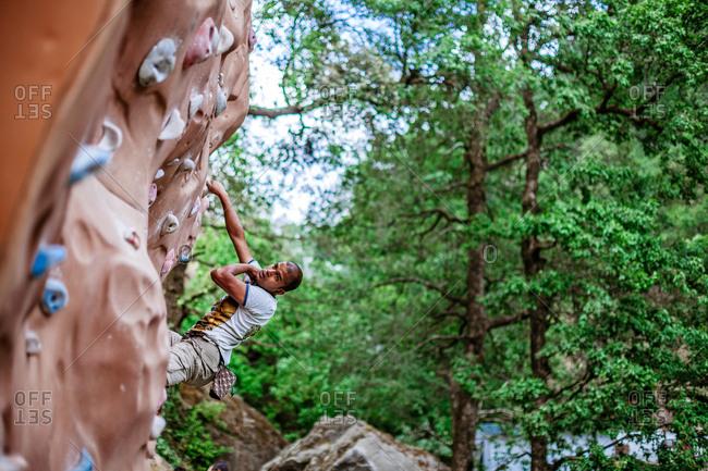 June 30, 2013 - Nainital, Uttarakhand, India: Free climber hanging from rock wall