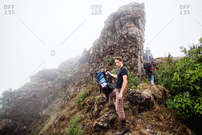 June 6, 2013 - Nainital, Uttarakhand, India: Hikers climbing up a ridge in fog