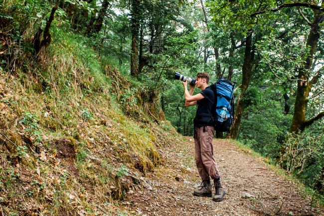 June 6, 2013 - Nainital, Uttarakhand, India: Photographer using a telephoto lens in forest