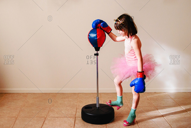 Girl in a tutu with boxing gloves
