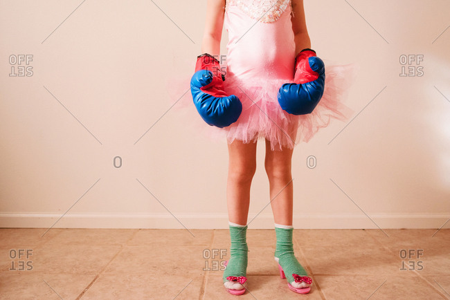 Girl in tutu with boxing gloves
