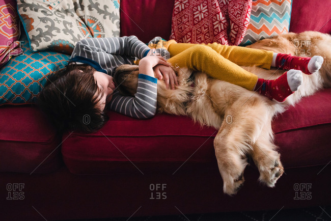 Girl napping with golden retriever