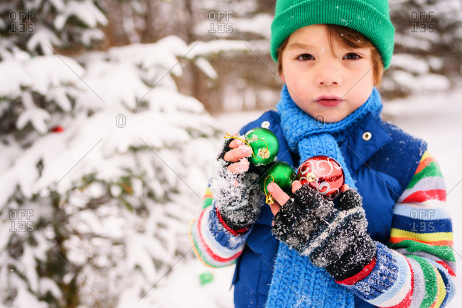 Boy with ornaments in a winter field
