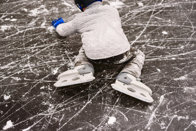 Young boy on ice with skates
