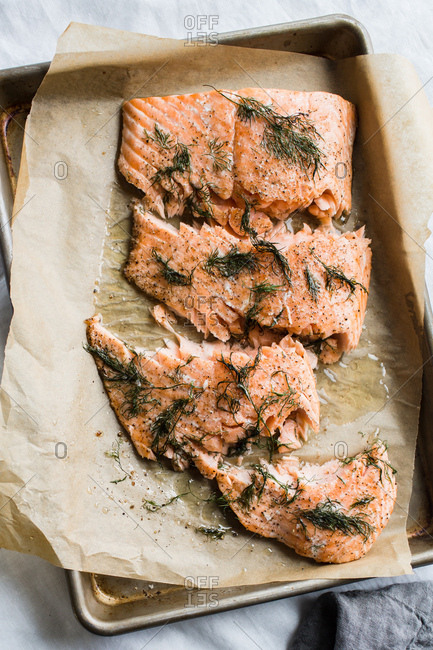 Salmon on pan cooked with herbs