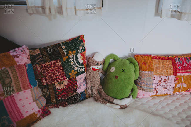 Stuffed animals on a camper bed