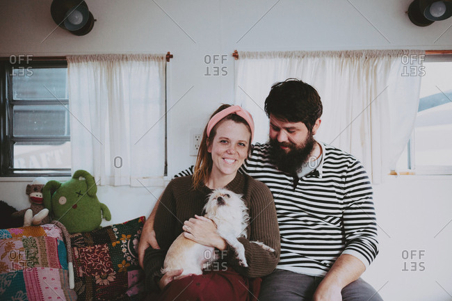 Couple with dog in camper