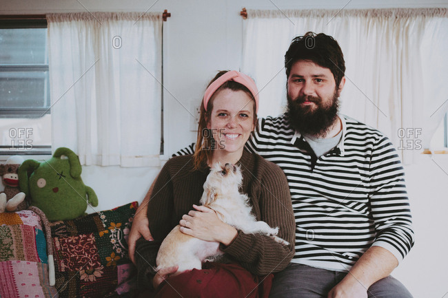 Couple with a dog in a camper