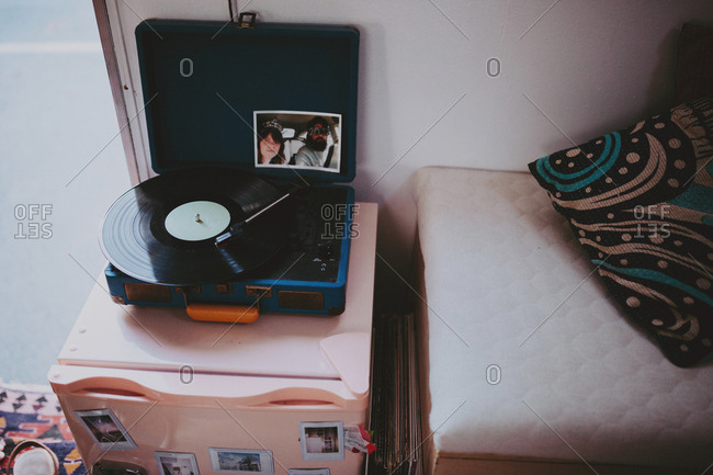 Photo of couple on a record player