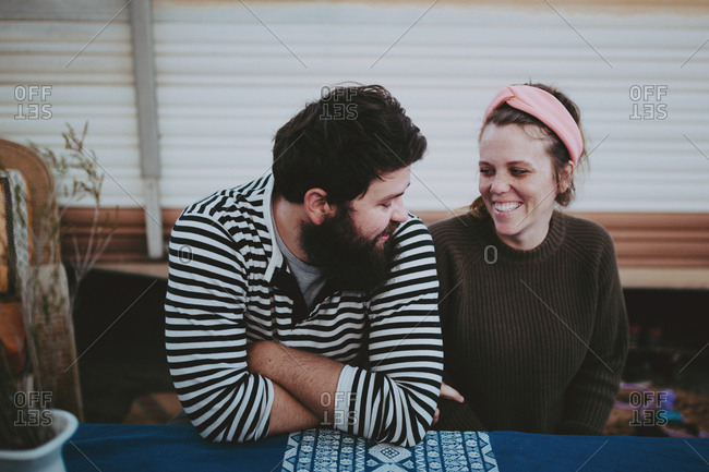 Smiling couple at RV picnic table