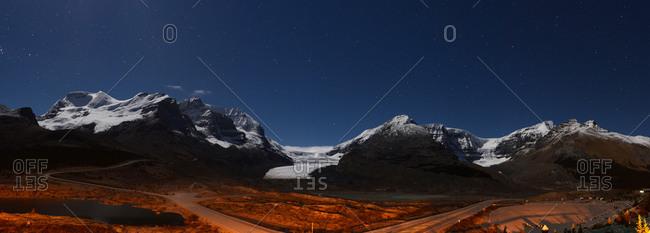 Glacier landscape lit by moonlight in Alberta, Canada.