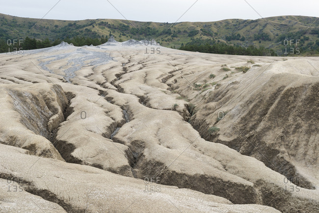 The desolate landscape of the Berca mud volcanoes was formed by erupting mud and gas.