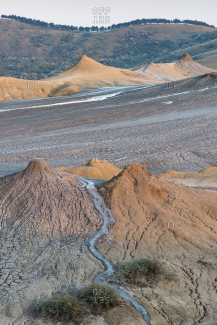 Land formations at the Berca mud volcanoes were produced by erupting gas and mud.