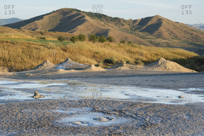 The desert terrain of the Berca mud volcanoes was formed by erupting gas and mud.