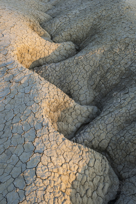 Cracked and flaking mud formation at the Berca mud volcanoes.