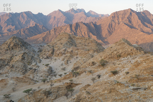 Morning light coats the Hajjar mountains at sunrise.