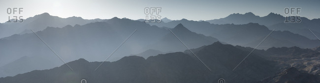 Panoramic view of misty peaks of the Hajjar mountains.