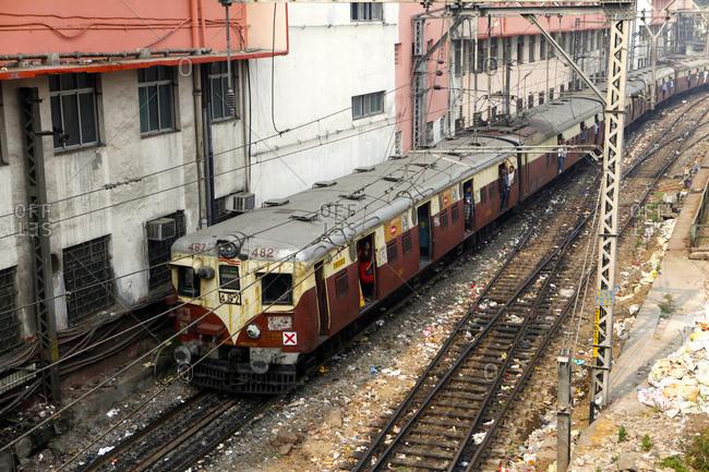 Mumbai, Maharashtra, India - December 19, 2015: A train comes into the station at Mumbai Central Local Station.