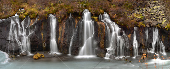 Waterfall coming out of ancient lava flows in Iceland.