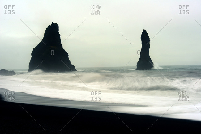 The mysterious black Reynisfjara beach on the south coast of Iceland.