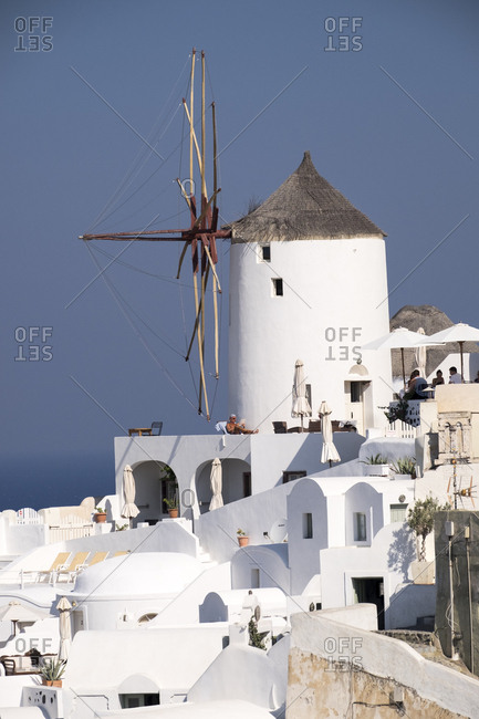 Greece - September 16, 2016: Old fashioned windmills in the picturesque town of Oia, Santorini.