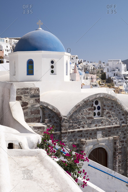 A classic blue dome of a Greek Orthodox church in the picturesque town of Oia, Santorini.