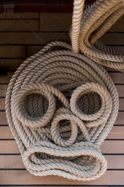 High angle view of a rope lines secured in an orderly and decorative fashion.