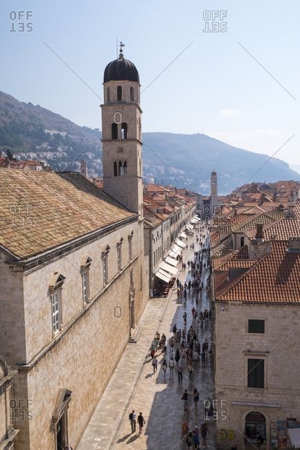 Dubrovnik, Croatia - September 4, 2016: Stradun Street and city bell tower in Dubrovnik's Old Town.