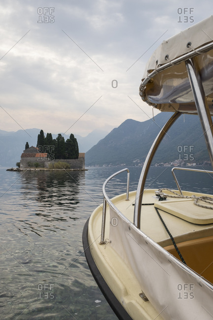View of Saint George island with a tourist boat in the Bay of Kotor.