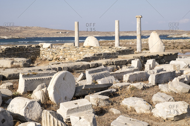 Parts of a monumental sculpture of Apollo at the Delos archaeological ruins in Greece.