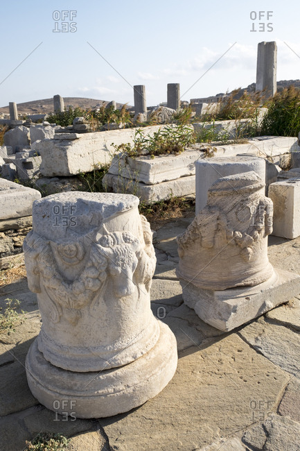 Decorative ancient stone altars with the heads of calves at he Delos archaeological ruins in Greece.