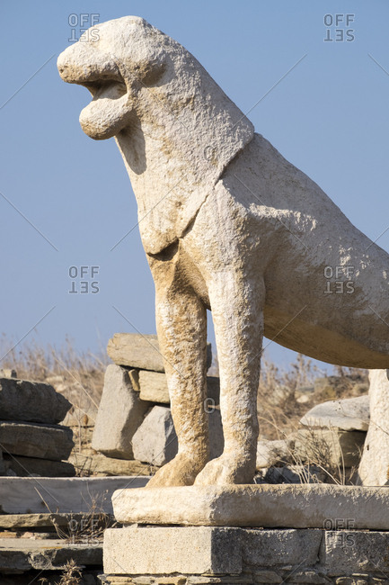 A stone reproduction of the original Naxian lions sculpture at the Delos archaeological ruins in Greece.