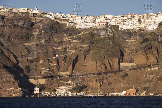 Greece - September 16, 2016: The town of Thira with its steep donkey path leading from the port up to the main town, which is perched on the caldera cliff in Santorini.