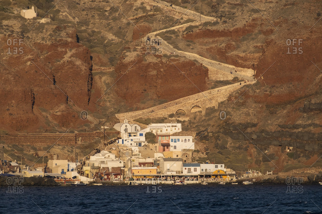 Greece - September 16, 2016: The town of Oia with its steep donkey path leading from the port up to the main town, which is perched on the caldera cliff in Santorini.