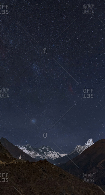Starry sky over Mount Everest and a stupa on the Everest base camp.