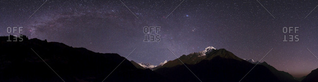 Panoramic view of Himalayas with the Milky Way over the Khumbu valley.