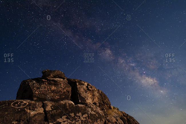 The summer Milky Way and ancient Native American petroglyph in the Owens Valley of Sierras.