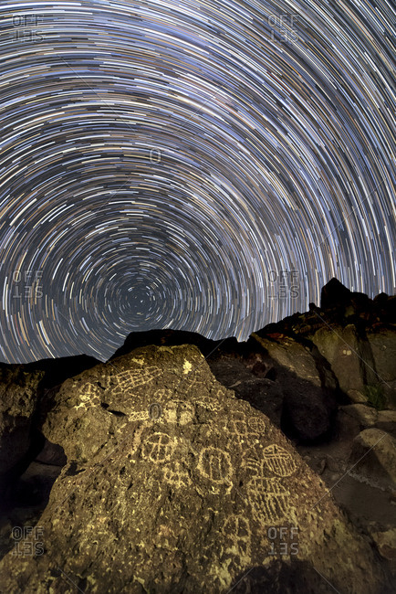 A time-exposure image of star trails shows the sky rotation around the north celestial pole, from California's Owens Valley ancient petroglyph site.