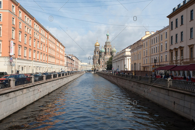 Saint Petersburg, Russia - September 12, 2016: Griboyedov Canal, with the Church of the Saviour on the Spilled Blood looking north from the Italian Bridge in Saint Petersburg, Russia.