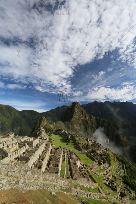 Machu Picchu ruins with Huayna Picchu mountain in the background.