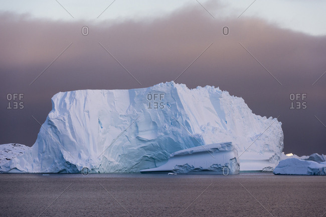 Icebergs under a stormy sky, Lemaire channel, Antarctica.