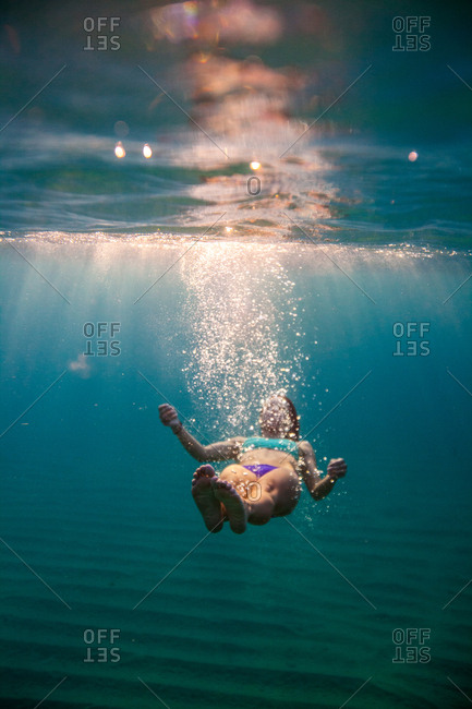 A girl swimming in the clear waters of Baja.