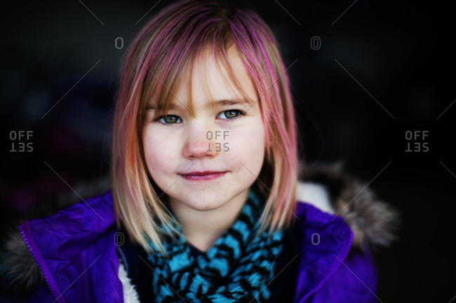 Young girl with pink streaked hair