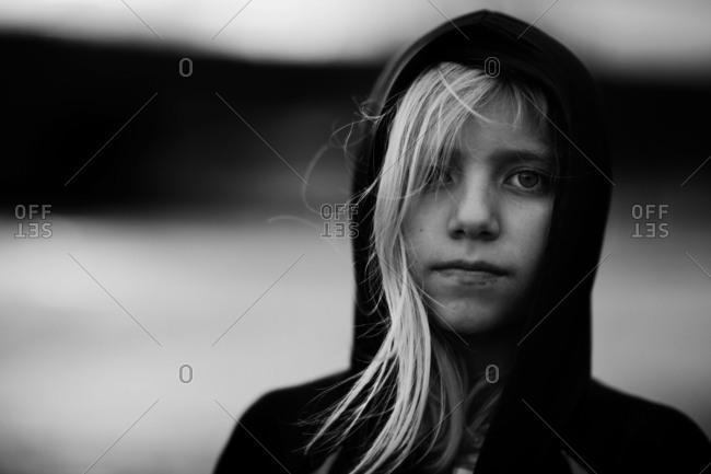 Beautiful young girl wearing hooded sweatshirt