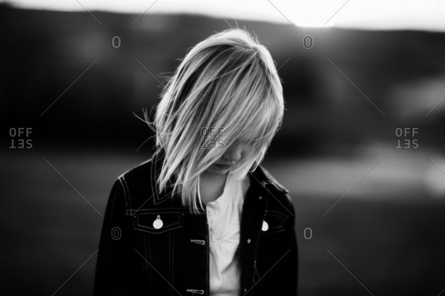 Young girl with blunt bob haircut and denim jacket