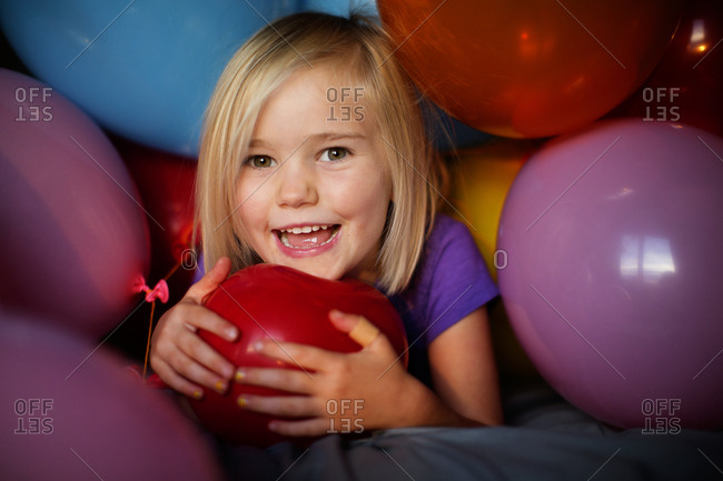 Cute young girl playing with balloons