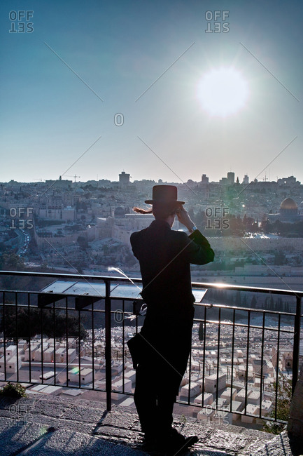 Young jewish man looking out over the Mount of Olives