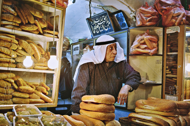 Old City, Jerusalem  - September 15, 2009: Man selling bread in a small shop
