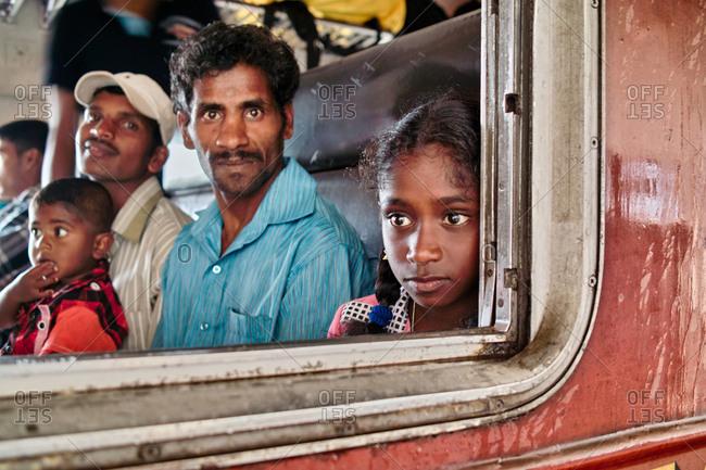 Nanu Oya, Sri Lanka - September 15, 2009: Close-up of a young girl on the Ella passenger train